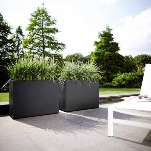 bloembakken vullen met bloemen. Black Bedroom Furniture Sets. Home Design Ideas